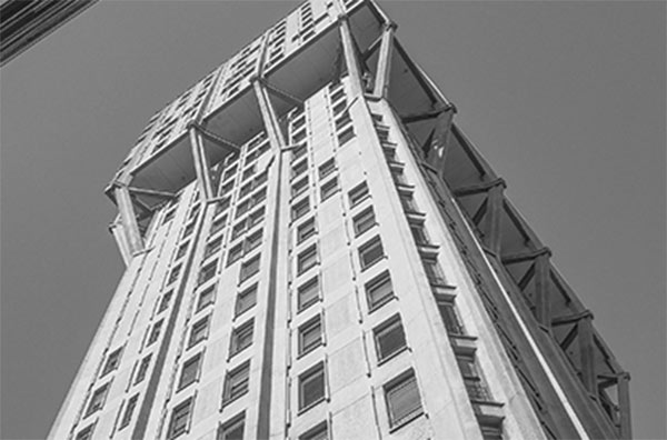 a black and white photo of a high-rise building