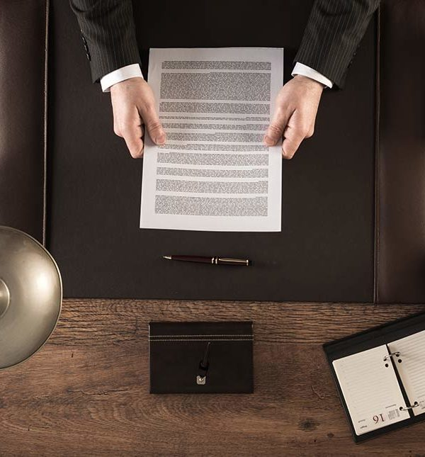 a man reviewing a contract