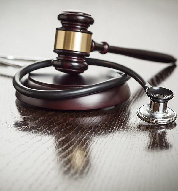 a stethoscope plus a gavel and block